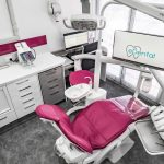 Top view of eDental Clinic at Rivervale. It has tables, dental chair, monitor screen that shows its logo and other tools to be used for dental procedures.