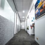 Hallway along with lots of office doors, wall, lights and that is considered as one of the dental clinic of eDental Perth.