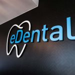 eDental logo on the clinic's black-painted wall.