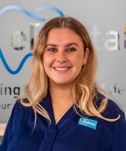 A staff from eDental Perth wearing blue uniform, namely Lana; Marketing Coordinator.