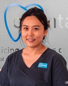 A nurse from eDental Perth wearing grey uniform, namely Olivia.