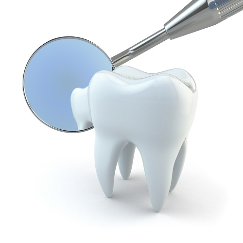 Closed-up of a tooth along with the magnifying-mirror and that represents the