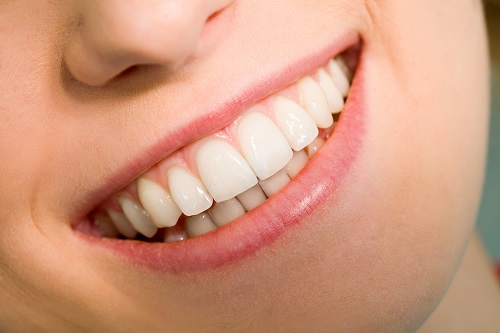 Focused woman's healthy set of teeth and that represents the