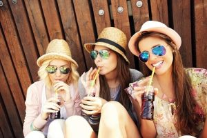 3 girls sitting and sipping a soft drinks, and as the header image of